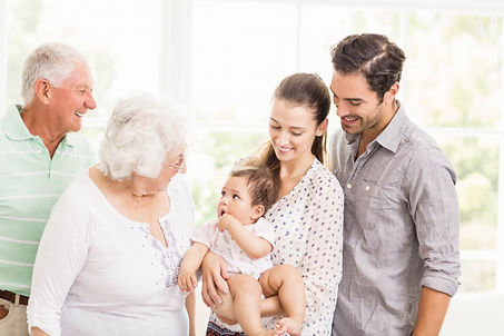 happy-extended-family-smiling-home_10742