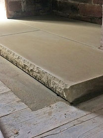 pitched edge Yorkstone fireplace hearth