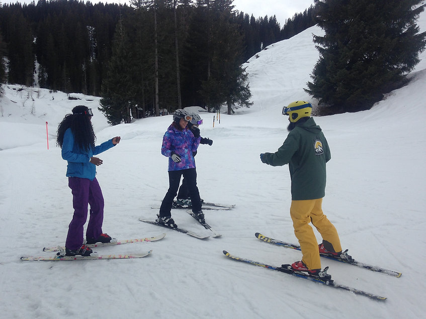 Take a frst time small group ski course in Davos or Klosters. A good time frame to get the basics down. You will be able to ski blue runs on your own!