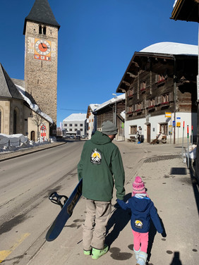 Gregor with Maira in the town of Klosters (yes we start them young). Our instructors would love to teach your kids to ski and snowboard in Klosters and Davos.