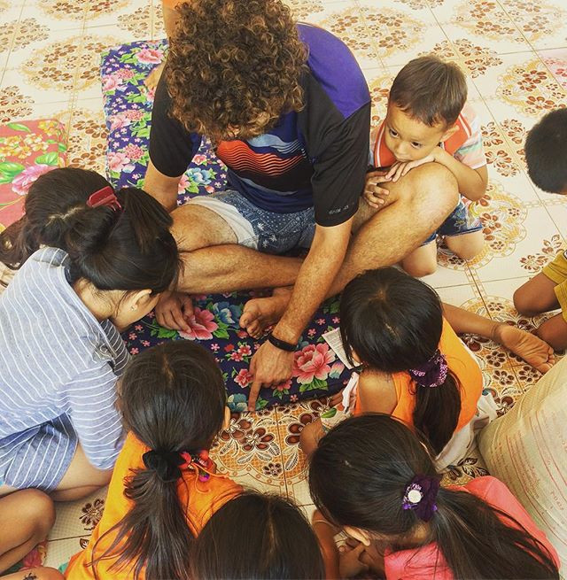 Playing games with the children at the temple