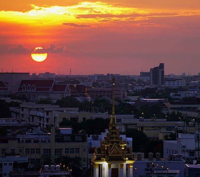 Photograph of Bangkok at sunset from the top of  Wat Saket, the Golden Mount.