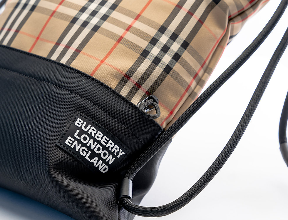 Close up of Burberry logo on front of bag