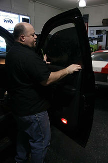 Dave tinting a window with 20%