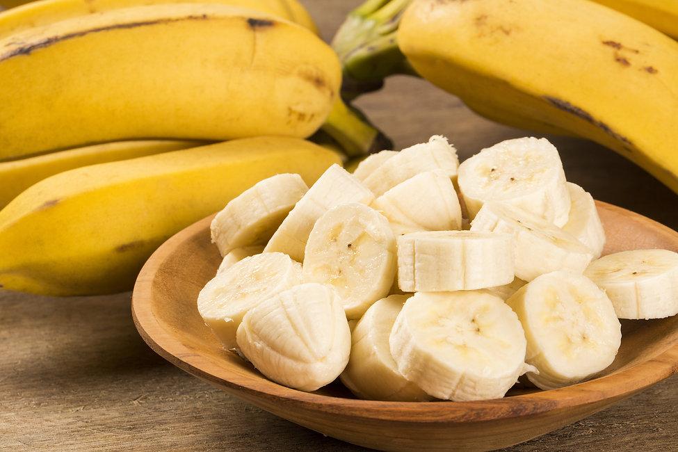 A banch of bananas and a sliced banana i
