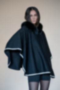 Model wearing wool blend poncho with black fur trim