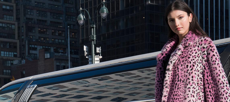 Model wearing pink leopard print coat