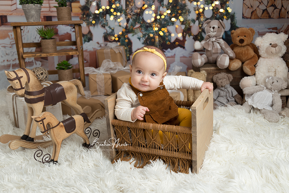 bebe fille lit macramé noel sapin lumières