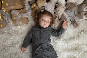 fille bebe noel nounours lumières cadeaux