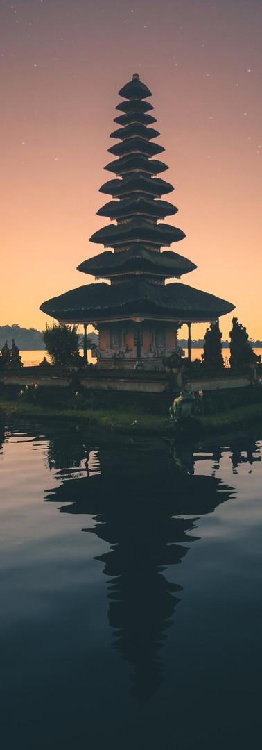 brown-pagoda-near-body-of-water-1694621.