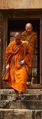 two-monk-in-orange-robe-walking-down-the