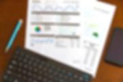 blue-click-pen-near-white-document-paper
