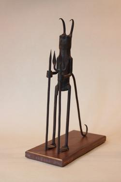 Statuette en métal. Océanie, XX ème.