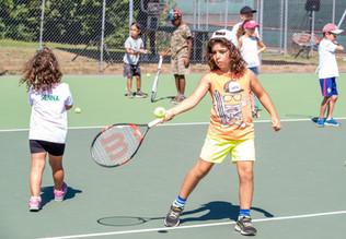 girl hiting the ball.JPG