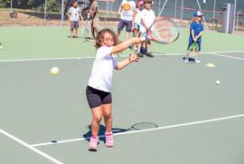 small girl hitting the bal .JPG