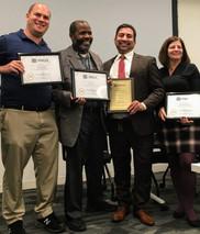Winners of the Breakthrough School Award: Principal Omar Crowder with teachers Omar Ali, Anita Romano, and Joel Legatt, Northeast High School