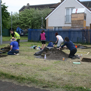 Schoolkids Digging as part of our Public Engagement Programme