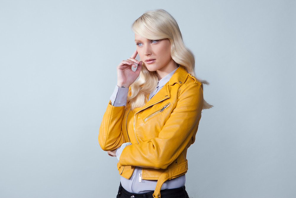 Lady in yellow leather jacket talking on cell phone