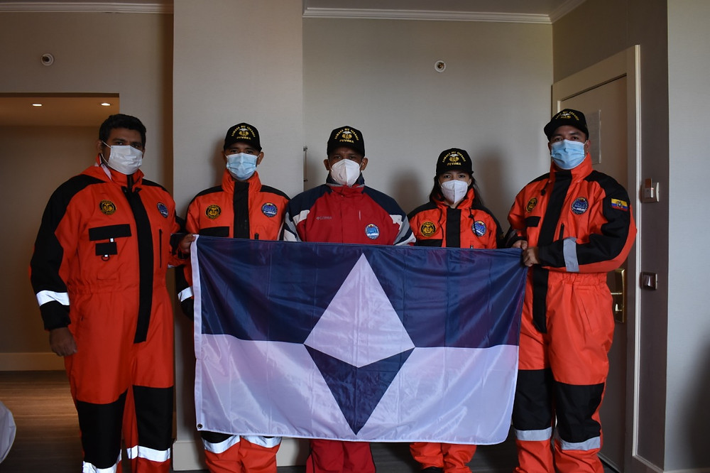 Members of Ecuador's national Antarctic program take a photo with True South before leaving for Antarctica