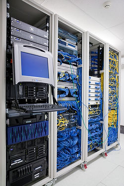 Photo of a server room rack with organized network cabling