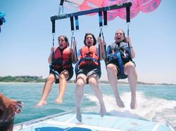 three girls parasailing