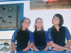 three girls on a boat