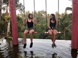 two girls swinging