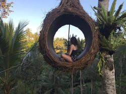 girl sitting in hanging circle