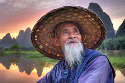 """Amazing Guilin photography tour: cormorant fishermen during sunset at the li river xingping china."""