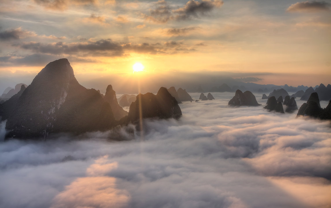 """Amazing Guilin photography tour: sea of clouds sunruse from xianggong hill yangshuo china."""