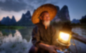 """Gorgeous Guilin photography tour: .Cormorant fishermer during dusk at the li river xingping china"""