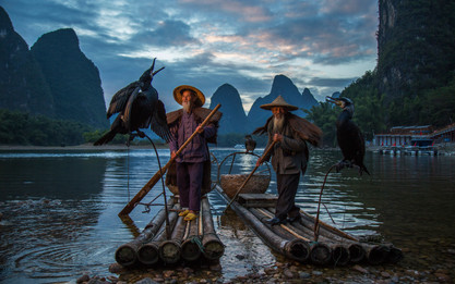 """Guilin cormorant fishermen photography: cormorant fishermen brothers during sunset at li river xingping china."""