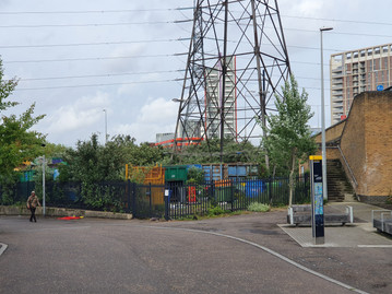 Scrap and recycled metal overspill from the surrounding industries that surround a pylon to the south east of the site
