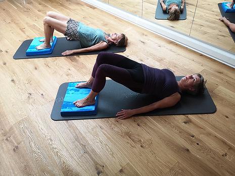 Übung Pelvic curl - Pilates Basel