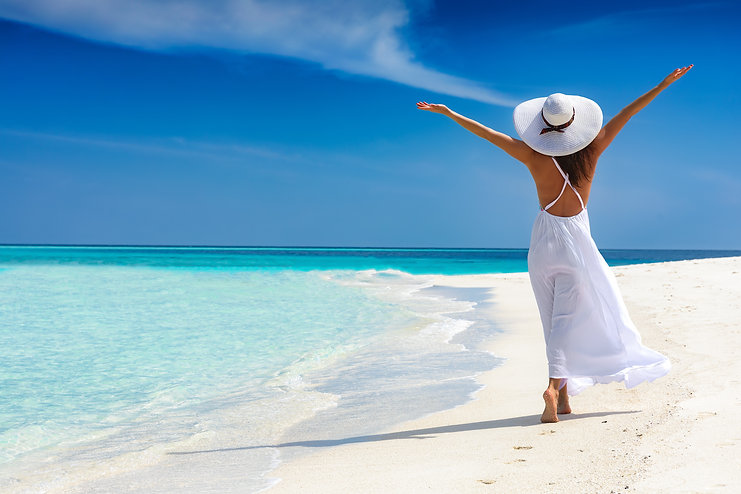 Happy traveller woman in white dress enj