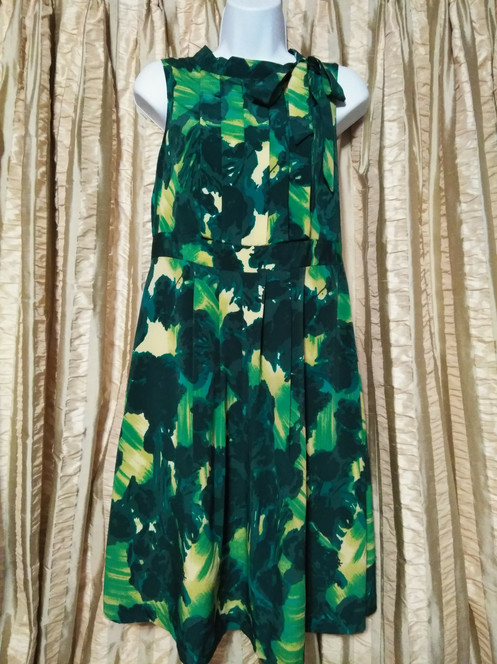 92f0372f690c Green and yellow sleeveless dress with an abstract print. Ties at the neck.  Side zipper. The bust measures 32 inches, waist is 30 inches, hips are 34  inches ...