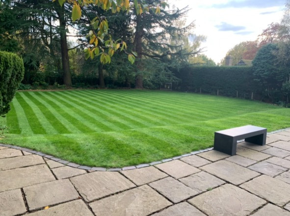 Kingsbury Lawn Care | Lawn Treatment Service | This image is of a freshly mown large lawn in neat stripes