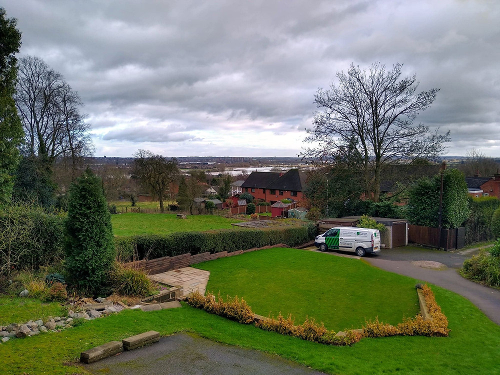Kingsbury Lawn Care / lawn treatment service / this image shows flooding in Tamworth with a green lawn and van near