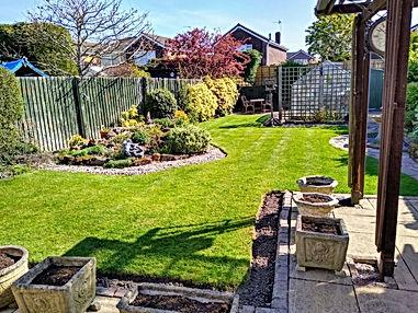 Lush green lawn following spring treatment