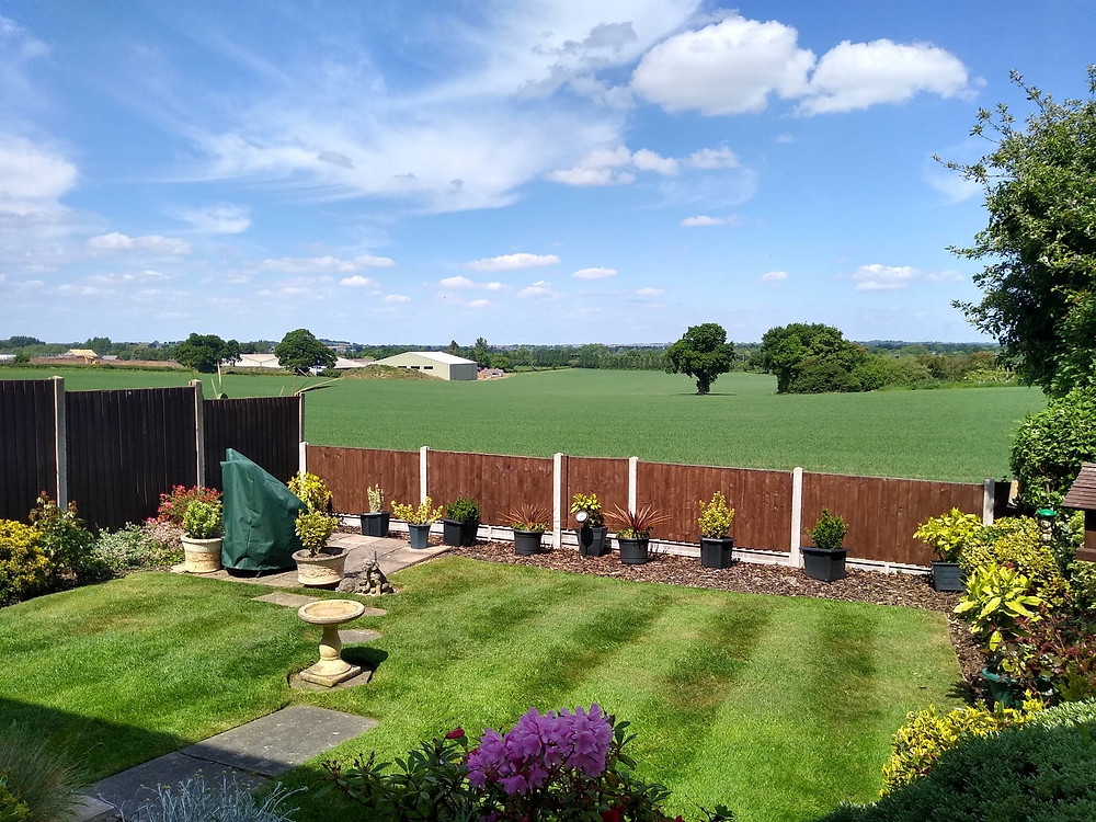 Kingsbury Lawn Care / /lawn treatment service / this image is of a striped lawn with a lovely rural view