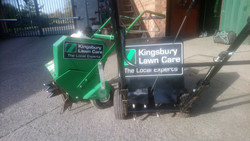 Lawn aerators including hollow-tine