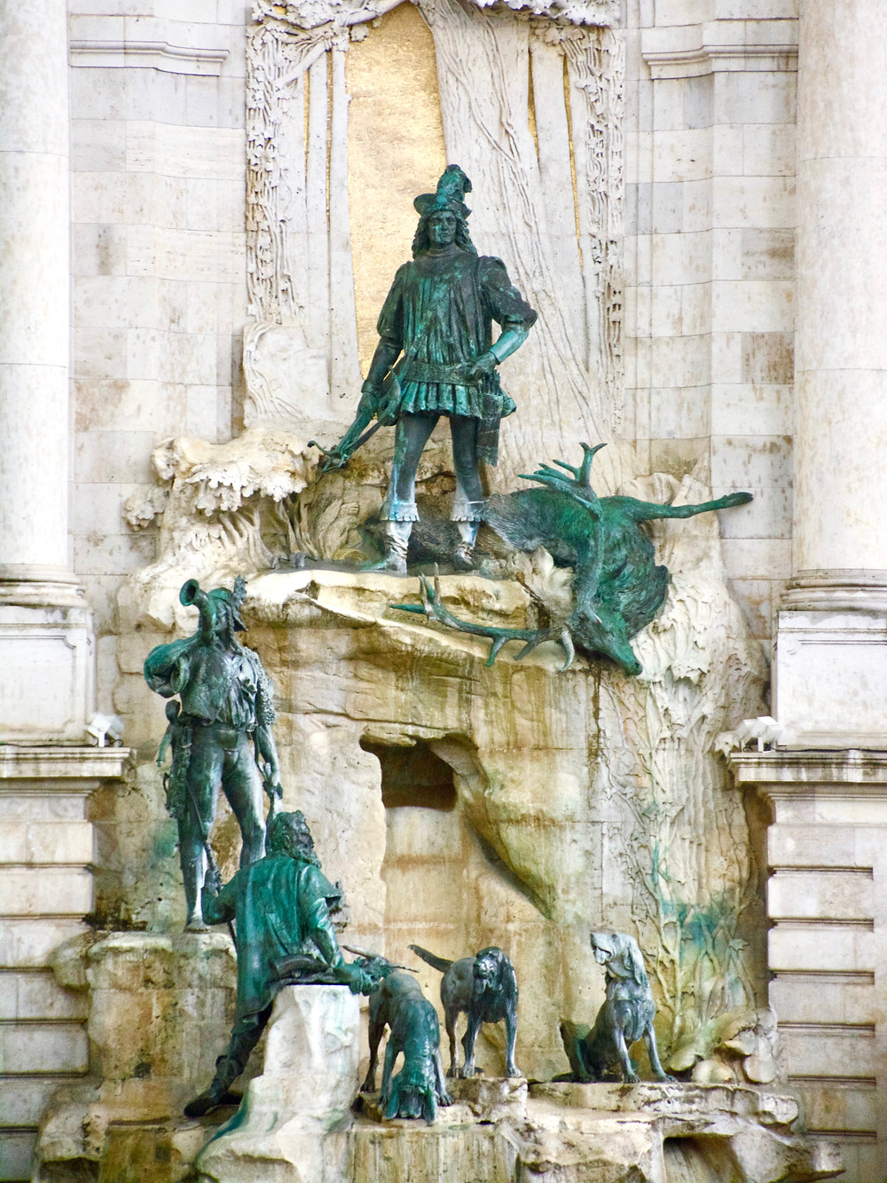 The Mattias Fountain with turquoise bronze figures of hunters, their dogs, and killed stags at the Buda Castle in Budapest