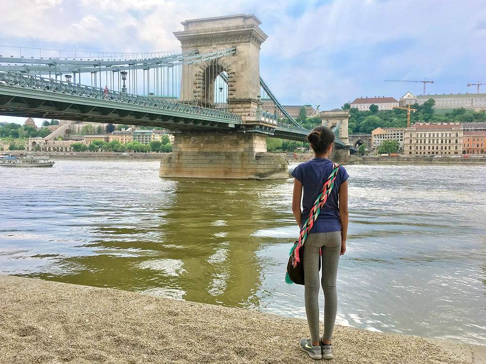 Eryn standing at the Danube River bank before the Széchenyi Chain Bridge crossing over to the Buda side of Budapest, Hungary