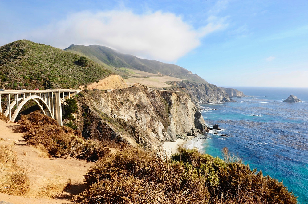 Bixby Creek Bridge stands in the backdrop of Big Sur's rocky coasts and seas