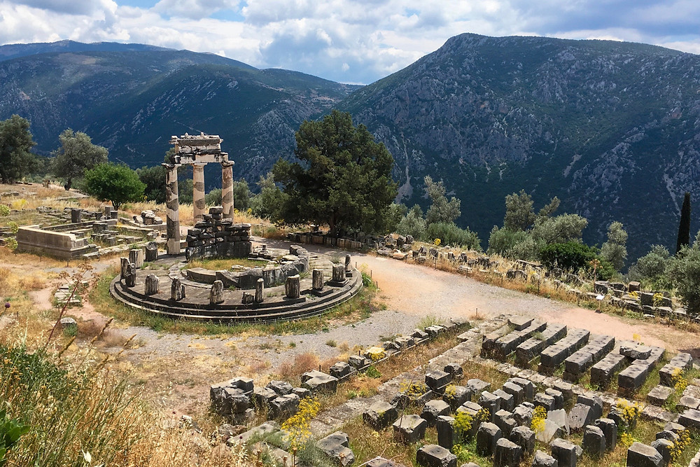 The ruins of the tholos and other structures in the Sanctuary of Athena Pronaia in Delphi, Greece