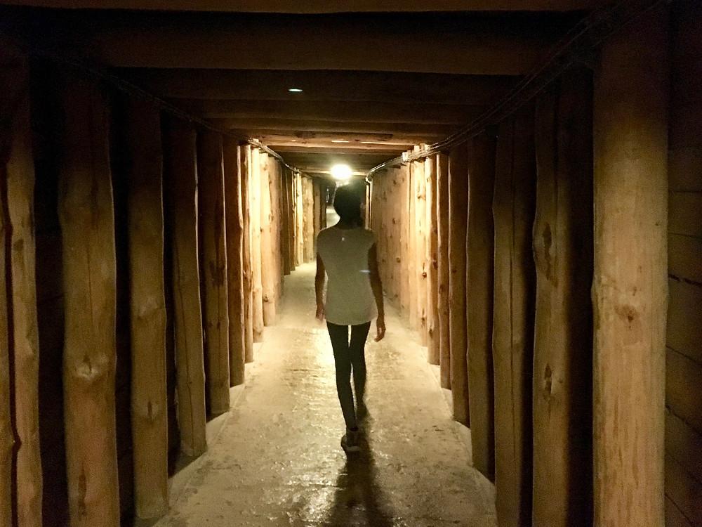 Eryn travels through a corridor in the Wieliczka Salt Mine
