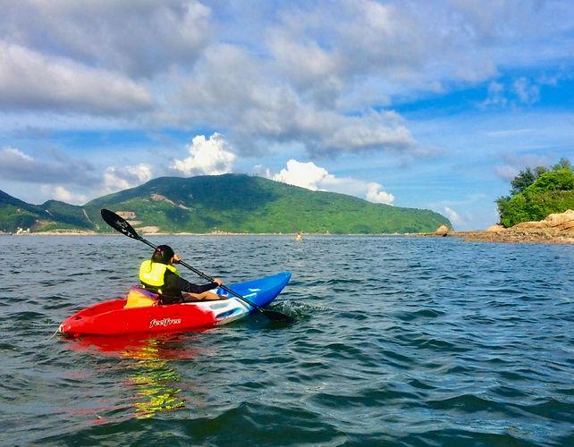 Eryn rows a kayak in Stanley Bay, Hong Kong