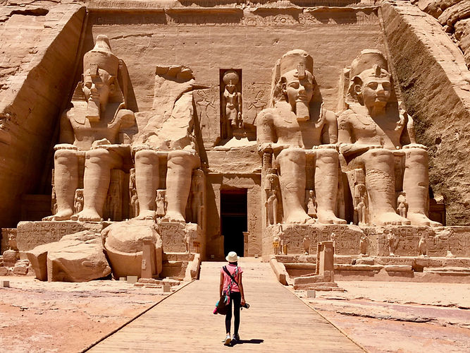 Eryn walks toward the entrance of the main Abu Simbel temple that is carved into the cliff face with its ancient Egyptian figures