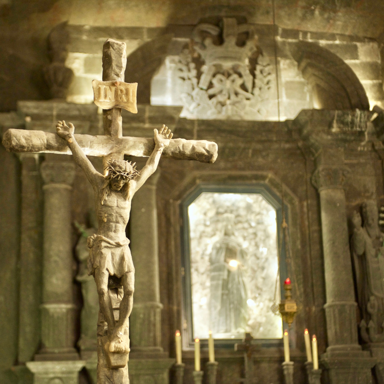 Travel photography of a salt sculpture of Jesus on the cross in the St Kinga Chapel