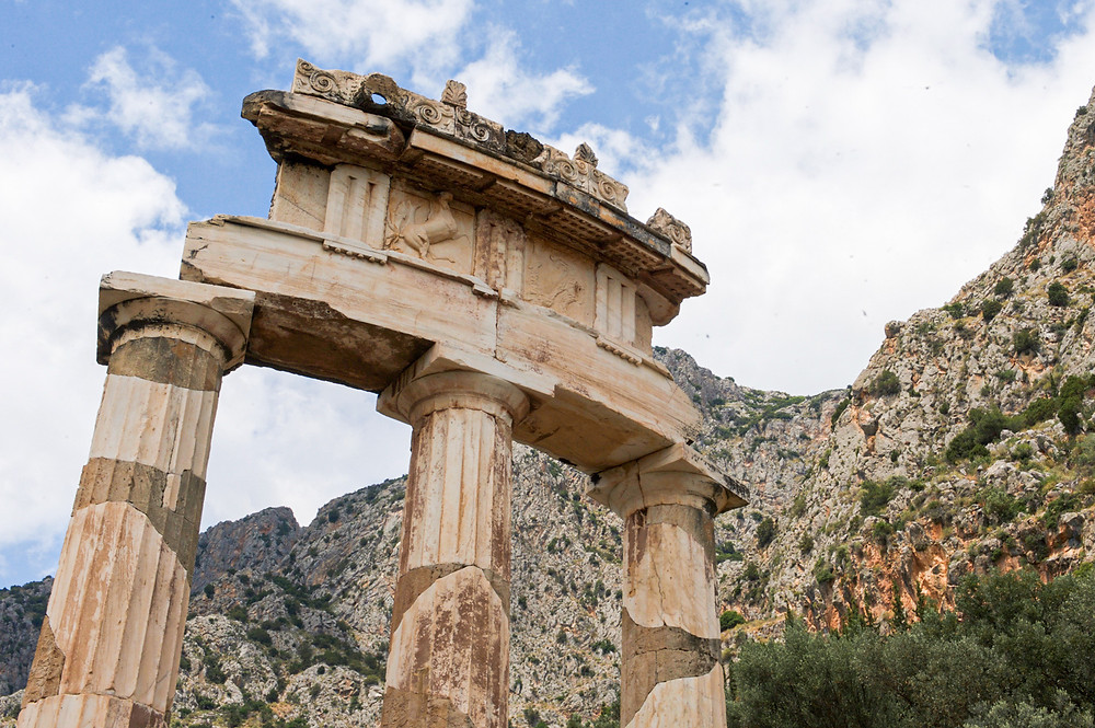 The connecting arch above of the three reconstructed pillars of the Tholos of Delphi, Greece